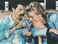 Football cup. Freddie Mercury and Roger Taylor
