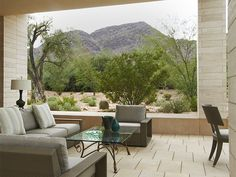 """Designer and 1stdibs dealer Jan Showers selected a vintage coffee table and lamp from her own inventory to complete the look of this project in Paradise Valley, Arizona, which was eight years in the making. """"We wanted to do something that was comfortable and serene that highlighted the outdoor space but not compete with it,"""" she says."""
