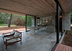 This rural Argentinian home was built from intersecting slabs of timber-imprinted concrete and sheets of glass.