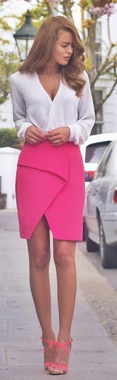 Honey-haired, mauve-lipped, tanned Nada Adellè in V-neck sheer snowy blouse, magenta wrap pencil skirt, coral strappy shoes
