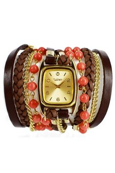 These unique watches incorporate everything you need to spice up your outfits. From leather cords to beads to chain link bracelets, the all-in-one watch design creates a series of stacked bracelets hugging a chic timepiece. We love it for dressing up the LBD or adding some funky flavor to your favorite jeans and tank. Stone: Orange coral Colors: Orange, brown and gold Materials: Genuine leather, Metal chain links watch Face: 14 Karat Gold Overlay Movement: Japanese quartz Water resistant: 1…