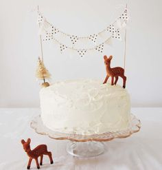 For Reuben's forest animal cake, but with more animals, less christmas tree. Cake bunting from KikiLaRu on Etsy.