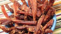 Homemade spicy salmon jerky is easy to make using marinated salmon that is put in the food dehydrator and is great for snacks and hiking.