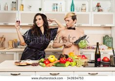 Man and woman on the kitchen room  with fruit and vegetable