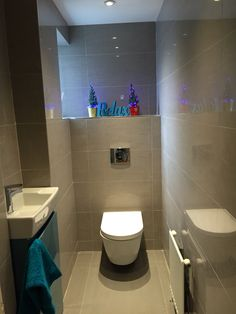 Grey tiles cloakroom toilet