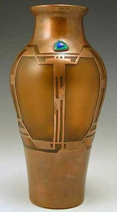Orange glass vase with copper overlay in a secessionist Art Nouveau design. The glass has a slight irridescent wash giving a matt appearance.