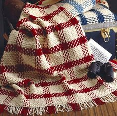 Show off your team spirit by bringing this crocheted blanket to every game! Crochet a Comfy Plaids Blanket in your school colors to show support to your local players and school. Go, team, go!