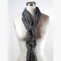 Give your necklaces a break and tie a scarf in a knot row to dress up your outfit instead.