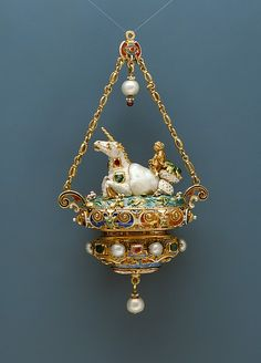 Reinhold Vasters (German 1827–1909). Pendant with a Triton Riding a Unicorn-like Sea Creature, ca. 1870-95. Baroque pearl mounted with enameled gold set with pearls, emeralds and rubies and with pendent pearls. The Metropolitan Museum of Art, New York. The Jack and Belle Linsky Collection, 1982 (1982.60.382). #unicorn #jewelry