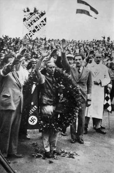 GP GERMANY (NURBURGRING) 1935 , Tazio Nuvolari Alfa Romeo P3 #12 receives the honours....have beaten all the Mercedes and Auto Union Cars ....note the nazi salute