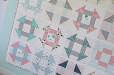Hyacinth Quilt Designs: Low Volume Churn Dash with a little fussy cutting.