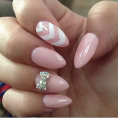 Baby pink and white bow nail art design perfect for you. If you're going with light colors, silver accents are the best which is why you should choose silver rhinestone to shape out your bow.
