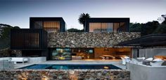 Waiheke Island home with striking stacked stone facade | Designhunter - architecture & design blog