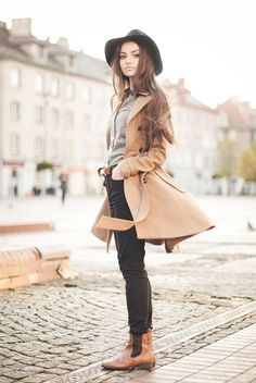 Grey button-up shirt, brown leather boots, black skinny jeans, camel beige coat