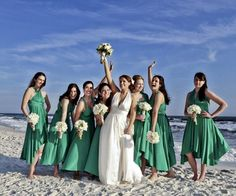Gorgeous beach wedding with the bridesmaids in twobirds Classic gowns (short straight length.)  The classic collection consists of one dress with over 15 ways to wrap so that women of all shapes and sizes can look and feel beautiful. Whether styled as the One Shoulder or the Grecian Twist, wear the twobirds Classic gown to flatter your body type. Then.. wrap it differently to wear again for a night on the town!