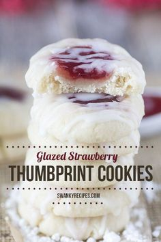 Glazed Strawberry Thumbprint Cookies with a buttery vanilla and almond flavored shortbread cookies filled with strawberry jam and drizzled with icing.
