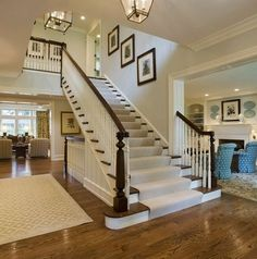 Classic Chic Home: Traditional White and Dark Wood Staircases.. Bannister in entryway.