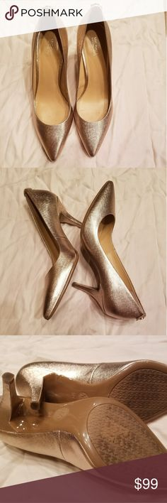 Michael Kors Rose Gold Pumps Gorgeous Rose Gold heels for a fancy night out or a special event. Worn once when I was a bridesmaid for my best friend's wedding. Normal signs of wear on the sole from walking around on cement, asphalt and tile the one day. Michael Kors Shoes Heels