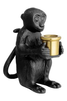 Metal candlestick: Metal candlestick in the shape of a monkey. Diameter of candle holder 2.2 cm. Width of candlestick 10 cm, height 13 cm.