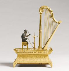 A French Palais Royale mother-of-pearl and gilt-bronze musical box/automaton ~Charles X, circa 1830