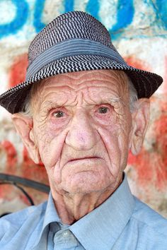 Old Man In The Hat   This guy was sitting in the shade outside the Roman ampitheatre in Durresi in Albania. Quite a character..