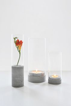 combine tubes of glass with ceramic, wood or concrete base