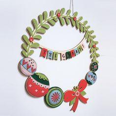 Personalised Christmas Wreath, Christmas Decoration, Personalised festive wall hanging, Felt Wreath, Felt christmas decoration by ConnieClementine on Etsy https://www.etsy.com/listing/250666374/personalised-christmas-wreath-christmas