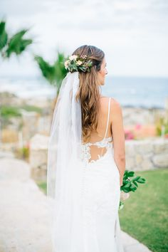 Bridal hair. Floral hair comb with veil. Half flower crown with flowers only in back and slightly on the sides.