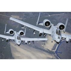 Two A-10C Thunderbolt II aircraft fly in formation Canvas Art - Stocktrek Images (34 x 23)