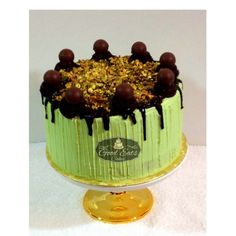 A Pistachio Delights Cake  A delicious 4 layered pistachio cake with   Rusted Chopped pistachios soaked in vanilla   Dark rum syrup, filled with 2 layer of cream cheese  Frosting with chopped pistachio, a center layer of  Dark chocolate ganache, frosted in a Pistachio gree
