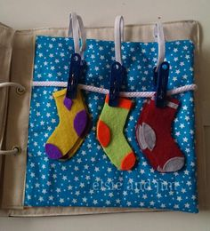 Match and peg the socks. Toddler quiet book.