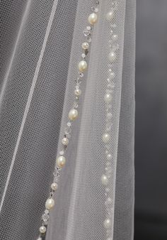 Veil Edged with Freshwater Pearls, Crystals, and Rhinestones Fingertip Length Shown.
