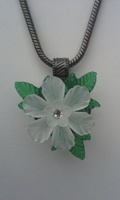 So pretty. Make any occasion or day at work special. An acrylic posy that just pops into your pendant, brooch, bracelet, or badge holder. The