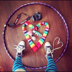 """These are the things that make my heart happy. Not just happy, but whole. I wholeheartedly love these things! As you can see, it doesn't require much: a hula hoop, some hipster sunglasses, a little sparkly body glitter, long colorful socks, my Canon camera, and my chucks."" - freeplaylife.com"