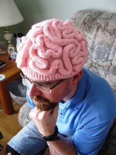 Free Knitting Pattern - Brain Hat Thinking Cap -You will need: 5mm circular needles (16inches) 5mm dpn 1 skein of Bernat Giggles Tickled Pink Tapestry needle Gauge: 24 rows x 20st = 4 inches Pattern: Cast on 76 stitches Join in round being car...
