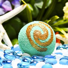 WAYFINDER Bath Bomb - $6.25 Tatou o tagata folau e vala'auina! Find your way with this bath bomb that embodies a true voyager. Read the wind and the sky as scents of tropical plumeria petals, ripe coconut, crisp salty sea spray, and seaweed fills your heart and takes your imagination to your very own ocean with dolphins jumping around the bow of your camakau. 5.9oz VEGAN