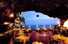 Grotta Palazzese, a restaurant located inside an ancient cave facing the Adriatic Sea .
