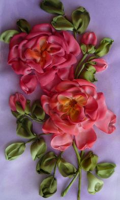 Pictorial shows how she uses plain white silk ribbon to create the flowers then paints the color onto the petals.  It looks like she uses ribbon that is one-sided and prefers to have mostly the matte side of the ribbon showing.