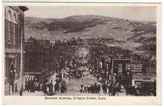 CRIPPLE CREEK, COLORADO LOOKING DOWN BENNETT AVENUE c1920's VINTAGE POSTCARD