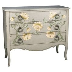 Traditional accent chest with flowing floral motif and antiqued drawer pulls.   Product: ChestConstruction Material: ...