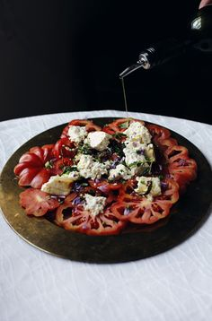 End of summer dinner: sliced heirlooms w/ warm feta, herbs, honey & black pepper. Serve with crusty bread and wine. Omg