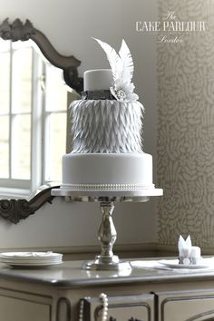 'CHARLESTON' Wedding Cake - 3 tier design with wafer paper feathers, sugar pearls and brooch in true 1920s style.