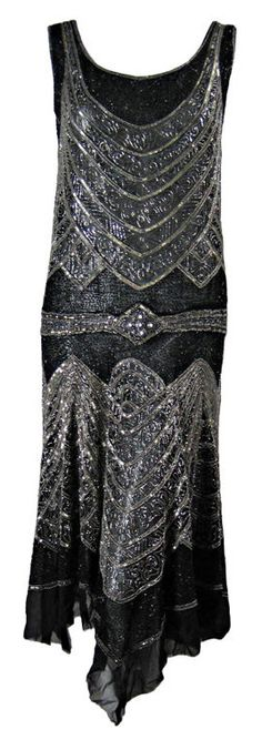 1920's Beaded Sheath Dress with Tromp L'oeil Detailing : France. This 1920's dress is a magnificent example of Art Deco wearable textile art. Fine black cotton fabric has allover adornment of black and silver sequins and glass beads.