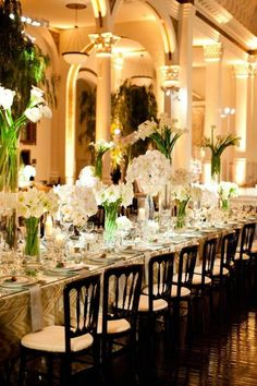 Love the flower arrangements for this table.