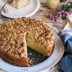 Moist and tender sour cream coffee cake with juicy peaches and a crunchy crumbly topping.