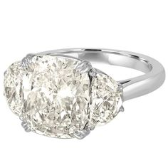 7.05 Carat Cushion Cut Diamond set with Half Moons in Platinum Ring Mounting | From a unique collection of vintage three-stone rings at https://www.1stdibs.com/jewelry/rings/three-stone-rings/