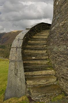 "Dolbadarn Castle is a fortification built by the Welsh prince Llywelyn the Great during the early 13th century, at the base of the Llanberis Pass, in Gwynedd, North Wales. The castle was important both militarily and as a symbol of Llywelyn's power and authority. The castle features a large stone keep, which historian Richard Avent considers ""the finest surviving example of a Welsh round tower"". In 1284 Dolbadarn was taken by Edward I, who removed some of its timbers to build his new castle…"