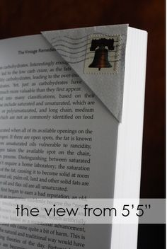 Envelope corner bookmark. Just snip the corner off of an opened envelope. Slide it over the corner of the page on which you stopped reading (I usually slide mine over 5 or so pages to help keep it secure).