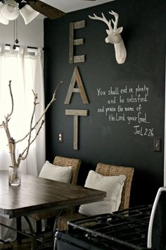 Dining Room with chalkboard wall, white deer head, & old wood EAT sign #home #decor
