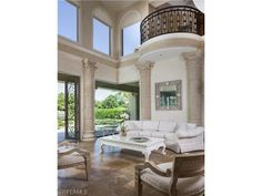 The Estates at Bay Colony Golf Club | Grand salon and balcony | Second story transom windows | Golf estate home on Waggle Way | North Naples, Florida
